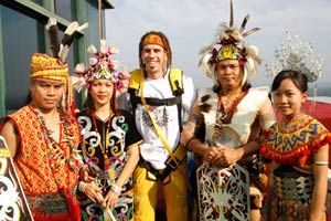 Douggs and Sarawak locals dressed in tradtional costume.